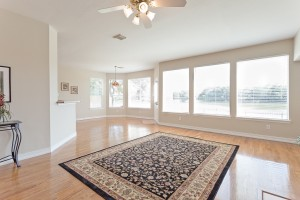 Hardwood floors in living area with beautiful water views.