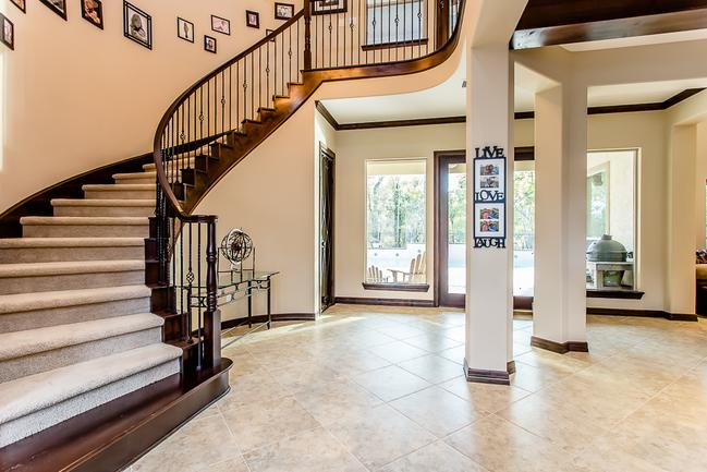 stunning entryway with grand staircase