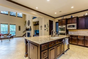 gourmet granite kitchen with stainless steel appliances