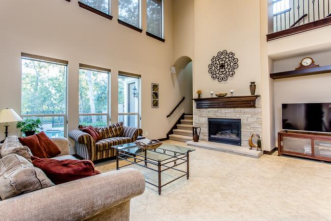 two-story living room with fireplace
