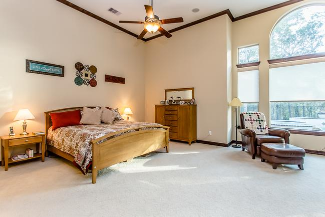 expansive master bedroom with sitting area