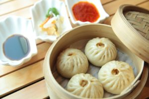 Steamed dumplings and sauces.
